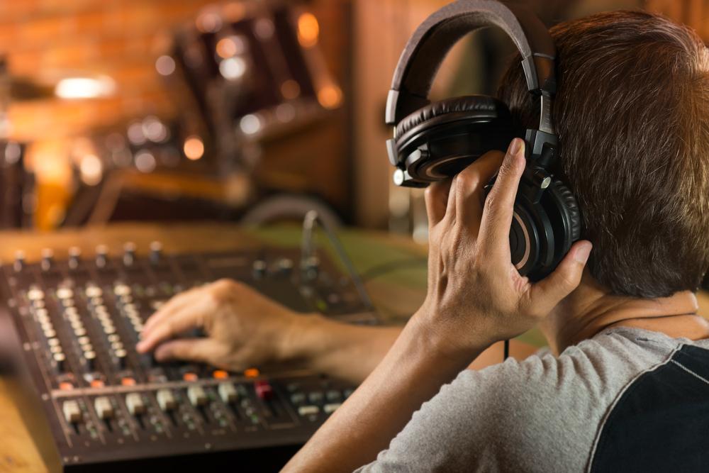 engineer listening to one headphone