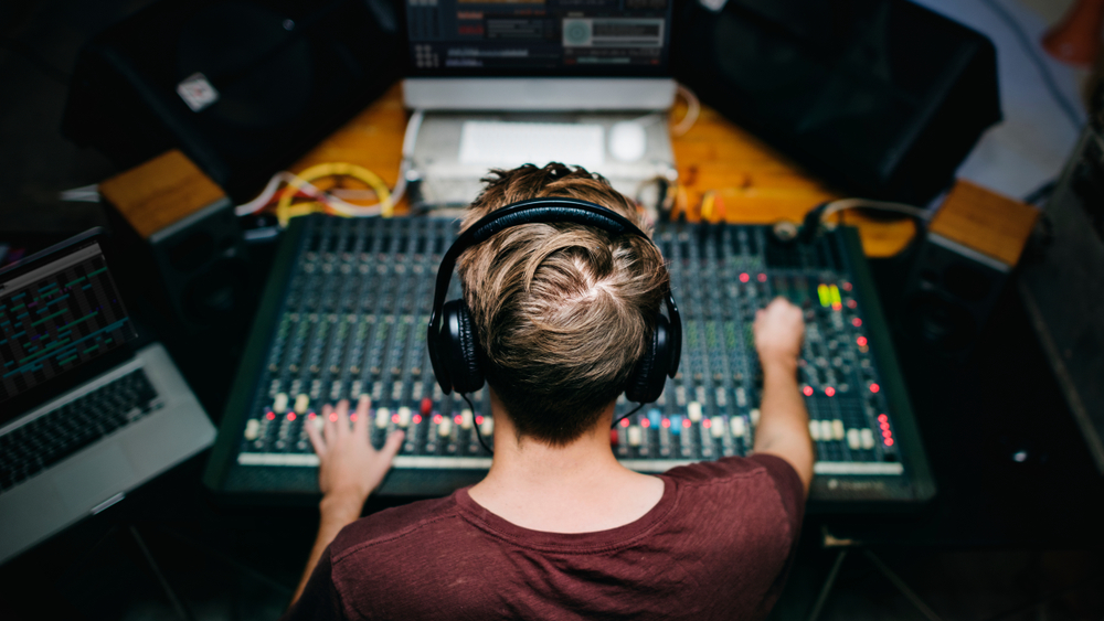 producer mixing track in studio