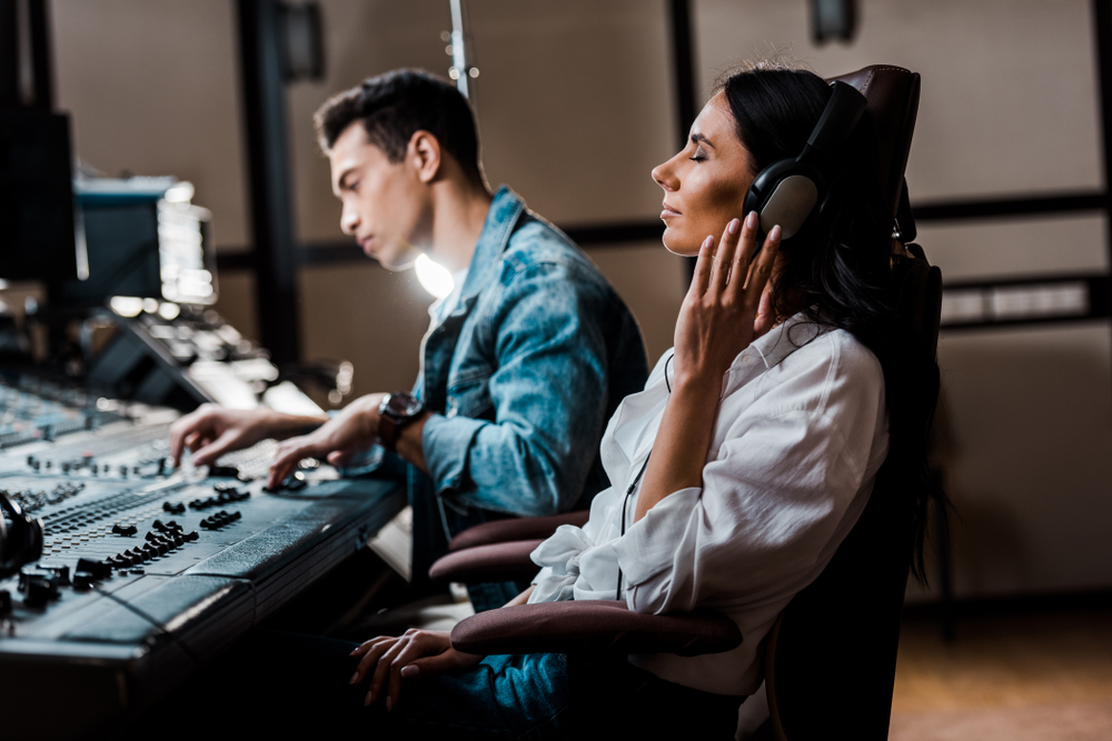 woman focusing on music in headphones