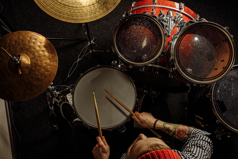 Top view of a young man playing drums