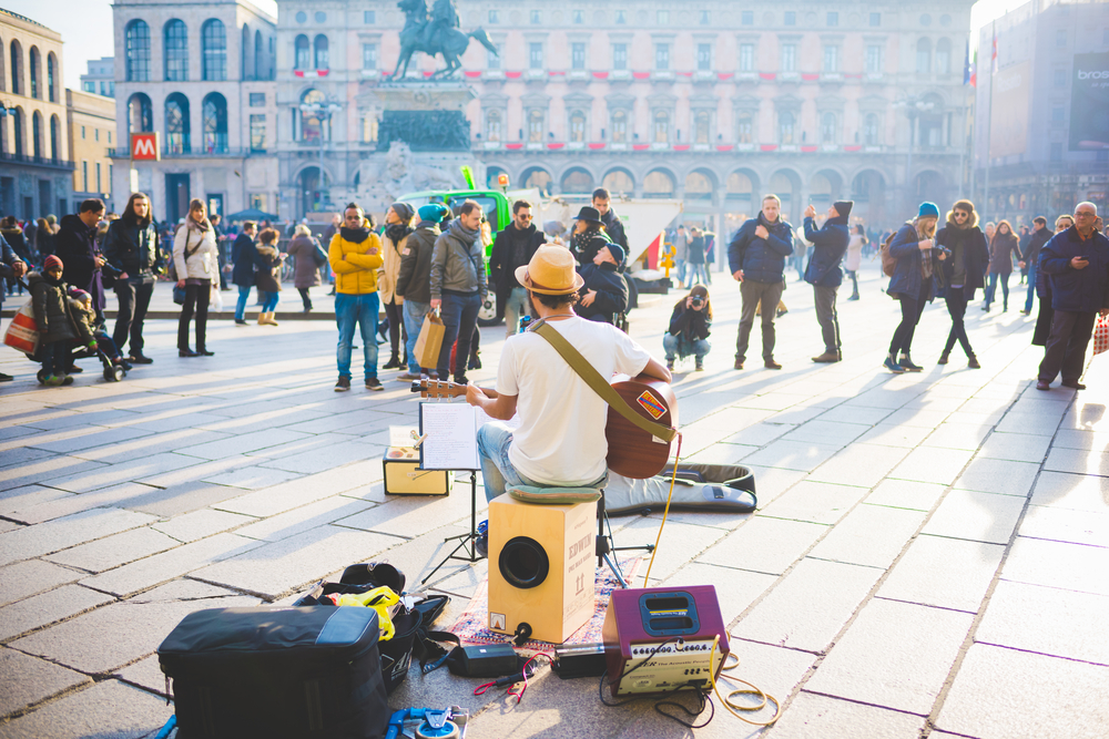 man performing on street to crowd