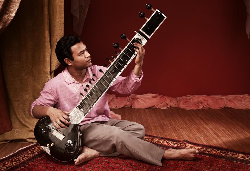 man playing sitar