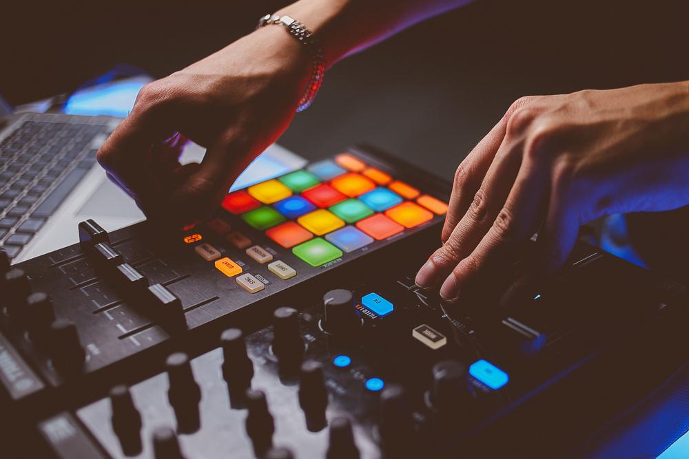 person using MIDI keyboard