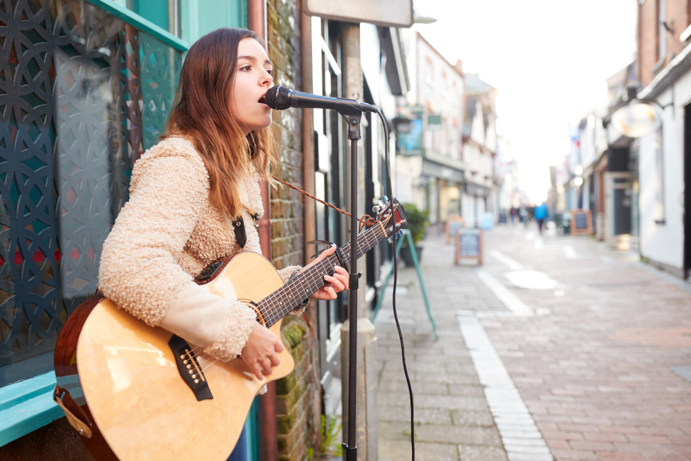 woman singing on street